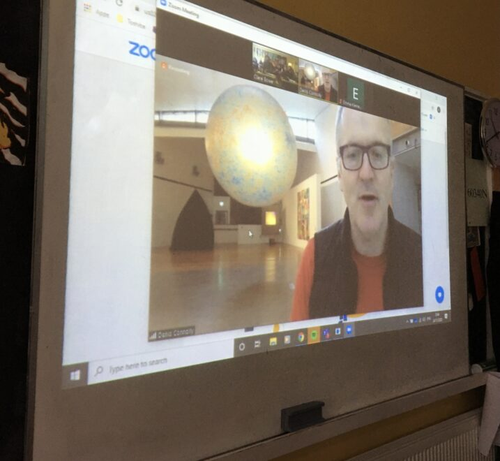Denis Connolly giving a virtual exhibition tour to a school group.
