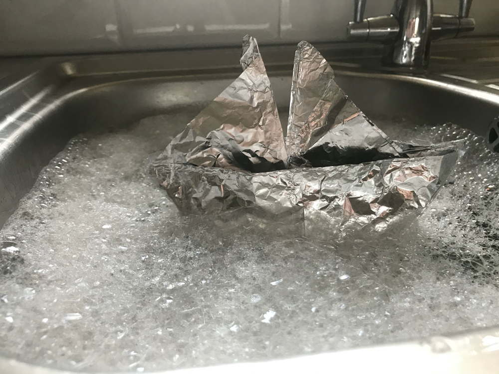 Tinfoil boat in sink