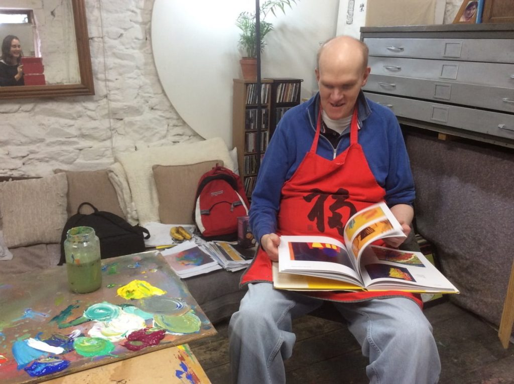 Photo: Tom O'Sullivan in fellow artist Tom Climent's studio space. Courtesy of the Artist and Crawford Supported Studio facilitator Mairead O'Callaghan.