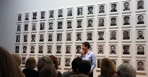 Photo: Amanda Dunsmore artist talk at the Hugh Lane Gallery, Dublin 2018 in front of her work 'The People's Portraits 1899 – 1918' (2018). Courtesy of the Hugh Lane Gallery.