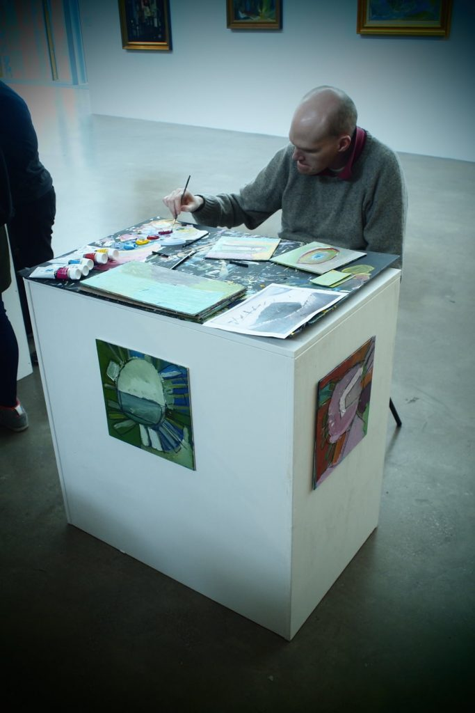 Photo: Tom working in the gallery during an Open Studio event. Courtesy of Hermann Marbe.